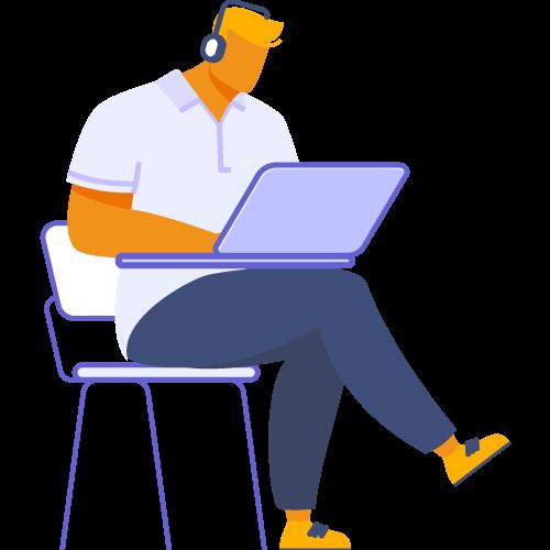 Persona sentada y frente a laptop