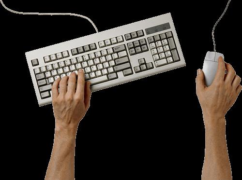 Manos en teclado y mouse